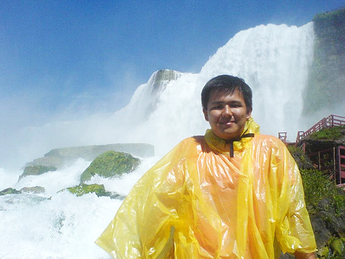 Posing in front of one of the falls at Niagara Falls, USA.